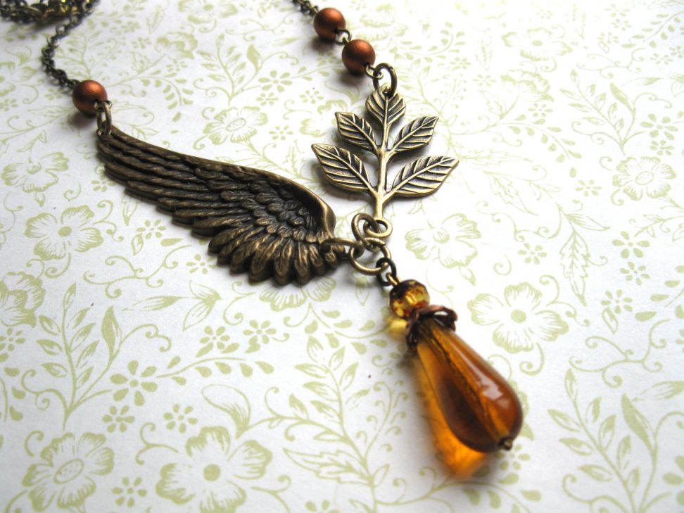 Amber teardrop necklace, glass beads, brass wing necklace