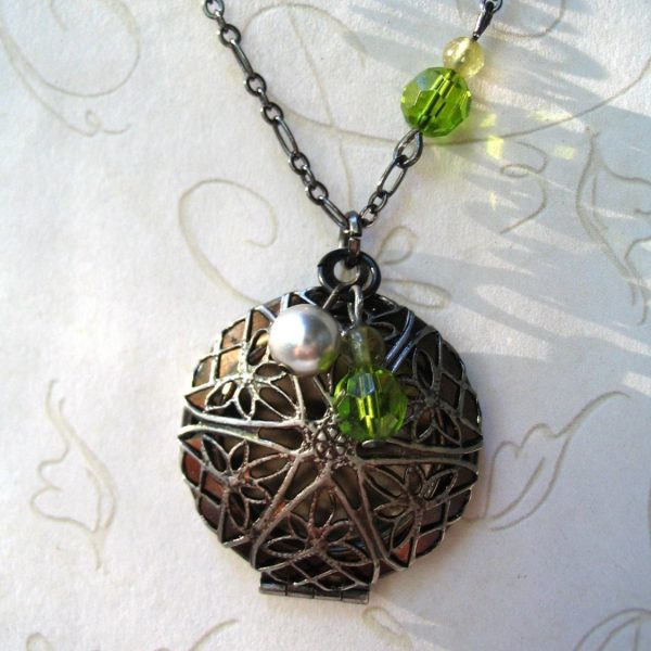 Filigree locket necklace, guntmetal